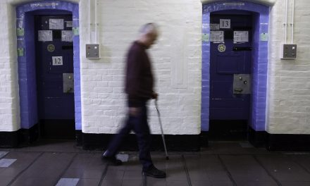 Man with a walking stick in Wandsworth Prison. Photo by Andrew Aitchison