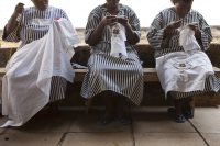 Women prisoners doing embroidery inside Thika Women's Prison, Kenya. Photo is by Andrew Aitchison