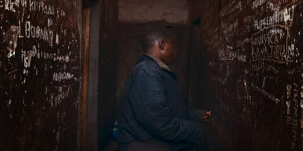 11 year old Marie, arrested for theft of a mobile phone, alone in a prison cell in Buhinjuza, Burundi. Photo by Nathalie Mohadjer.