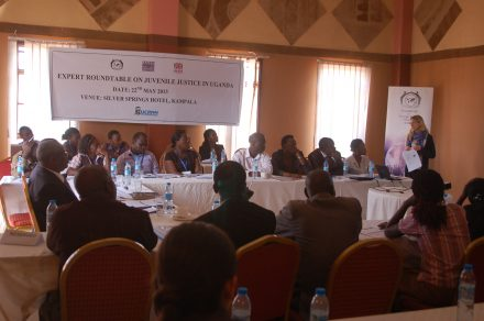 Participants at a juvenile justice roundtable in Uganda